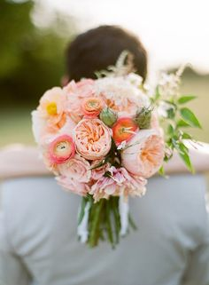 wedding bouquet: I love the ranunculus and the garden roses in this!
