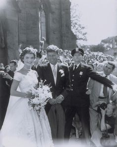 Among the photos discovered in the dark room of freelance photographer Arthur Burges was this photo of John F. Kennedy and Jackie after they tied the knot at St. Mary's Church in Newport, Rhode Island on Sept. 12, 1953.
