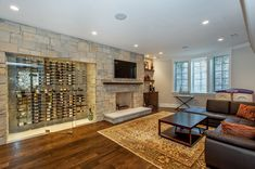 Wall Mounted Wine Glass Rack Basement Transitional with Accent Wall Basement Entertainment Area Brown Sectional Sofa Dark Wood Floor Family