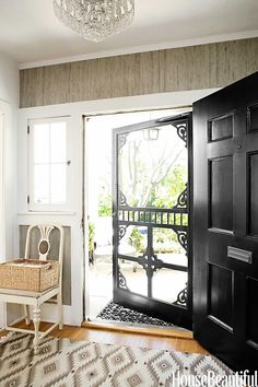 Entry that says welcome home! Victorian screen door, black front door, western rug! <3