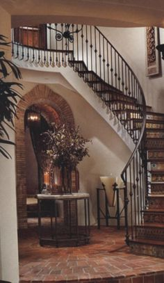 Hand forged wrought iron stair railings designed from historical records. Love this railing.