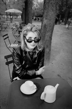 Catherine Deneuve in the Jardin du Luxembourg, Paris, 1997. Photo: Jeanloup Sieff