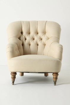 Love this chair. I can just imagine curling up in it in front of a fire with a glass of wine and a book.