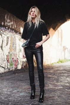 ectobuddha:  Camille Charriere whering black leather pants and sporting a Mulberry Delphie bag.