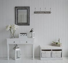White and silver hall furniture and accessories. Hallway decorating ideas from The White Lighthouse. Coat hooks, silver mirror, console table and storage bench