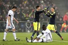 Mesut Ozil (right) rushes to celebrate with Perez following the Spaniard's second goal of the night in Switzerland