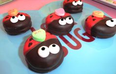 Ladybugs chocolate dipped Oreos.    Little love bugs.
