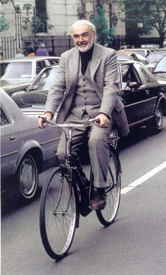 """We have a couple of photos of Sean Connery riding a bicycle. In this first shot, Sean Connery rides on the set during filming of Alfred Hitchcock's """"Marnie"""" in Nearly 40 yea… Sean Connery, James Bond, Finding Forrester, I Love Cinema, Hobbies For Men, Cycle Chic, Bicycle Race, Actrices Hollywood, Harrison Ford"""