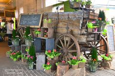 outrageous garden features and toolkit making ht meetup at milner, flowers, gardening, perennials, repurposing upcycling, When you first walked into the store you were greeted with this cool wagon decked out in pretty blooms Outstanding eye grab
