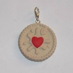 Mini Jammy Dodger Charm/Pendant - 1 handmade mini jammy dodger charm/pendant, created from Fimo polymer clay and comes with screw pin and lobster clasp attached.  Size: 3cm across