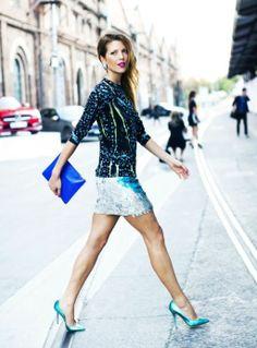 Street style - blue/black/yellow printed long sleeve top, electric blue clutch, metallic blue mini skirt & bright blue heels
