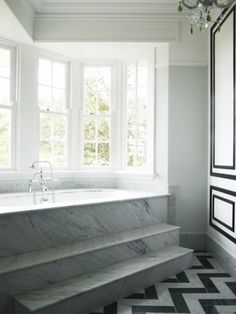 Love the windows and walk up to tub Lovely Marble Corner Bath