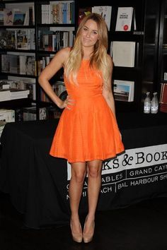 We love Lauren Conrad in bright orange - see some of her other best outfits here. Click for more!