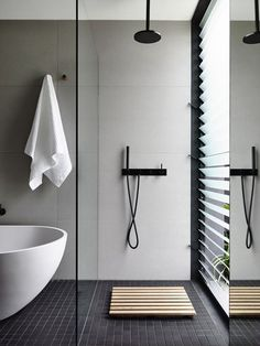 black, white, grey bathroom. bathtub. black fixtures.