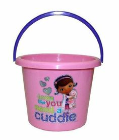 """Disney Doc Mcstuffin Pink Easter Plastic Bucket Beach by Disney. $25.00. Great to make an Easter Basket for the fan. Dimensions: 8.75"""" diameter x 7"""" H. Disney Doc Mcstuffin Pink Easter Plastic Bucket Beach. Materials: 100% polypropylene. Lambie with Doc Looks like you need a cuddle. Disney Doc Mcstuffin Pink Easter Plastic Bucket Beach, Jumbo Doc McStuffins Plastic Easter bucket that is perfect for children to collect Easter eggs or as a child's gift. The bucket is co..."""