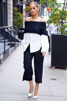 Look of the Day If Rita Ora had to work in an office, we'd guess this would be her take on workwear. She recently stepped out in a sweater-button-down hybrid off-shoulder top that she expertly styled with pleated cropped pants and white pumps. Rita Ora, Love Fashion, Fashion Looks, Womens Fashion, Vetements Clothing, Chic Outfits, Fashion Outfits, Chloe Sevigny, White Pumps