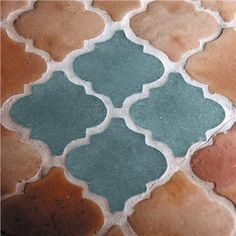 Shown here in combination with terracotta quatrefoil tiles, these crisp cast-glass quatrefoil tiles can be executed in a variety of colors, backlit to illuminate their translucent properties, and designed into your kitchen or bathroom as a floor, backsplash, or shower. } Glass Quatrefoil Tiles, $150 each on www.GlassArtistsGallery.com…