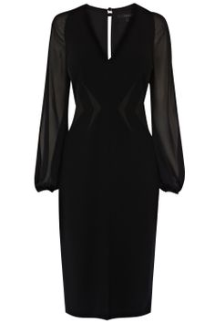 With sheer bell sleeves and a snug skirt, this chic dress has instant evening appeal. Cut with a gorgeous V-neck the Carly dress is nipped in at the waist with precise panelling that contour the body making for an enviable silhouette. The front split and back keyhole detail make for a unique finish. This fully lined dress is closed with a back concealed zip for a secure fit.
