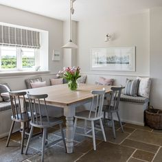 the kitchen-diner is the heart of family life. with a large table tucked into a bespoke seating area it feels cosy, informal and sociable Country Kitchen Tables, Kitchen Sitting Areas, Country Kitchen Diner, Kitchen Family Rooms, Booth Seating In Kitchen, Kitchen Benches, Kitchen Seating, Cosy Kitchen, Kitchen Seating Area
