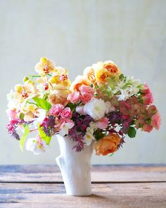 Bouquet of tuberose, orchid, begonia, hydrangea, spray rose, garden rose, succulent.