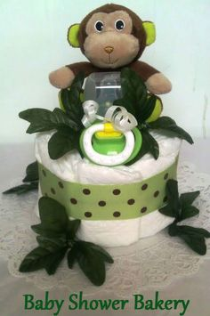 This is a sweet little jungle themed diaper cake. It will make an adorable centerpiece at a baby shower or a unique gift for mom-to-be. It is full of useful gifts!! #baby #shower #diaper #cake #centerpiece #decoration #jungle #monkey #Etsy #handmade $25