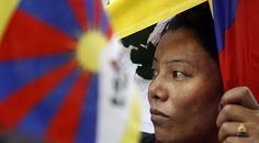 An exiled Tibetan woman protests during Tibetan Women's Uprising Day in New Delhi, India. Thousands of demonstrators staged protests against Chinese rule in Tibet.
