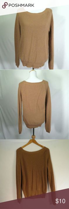 Wool Blend Crew Neck Sweater Camel Color This is a really cute relaxed fit sweater in the most perfect camel color. The fit is really relaxed but the bottom is more elastic. Didn't work for my body type but I think it would be great for somebody with smaller hips. Great condition. bishop + young Sweaters Crew & Scoop Necks