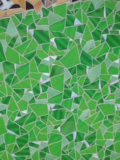 Detail view of Apple Store tile mosaic in Barcelona using colors from the Phone iOS app icon