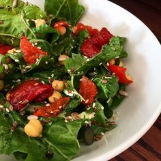 """Healthy body, healthy mind. Sundried tomato, raw chickpeas, peppadew and raw spinach salad - drizzled with flaxseed oil, lemon juice and seeds. #vegan"