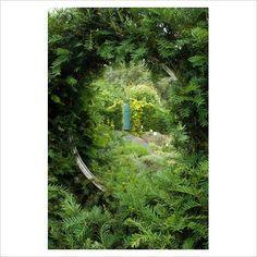 round window in yew hedge