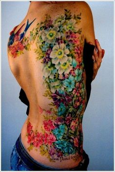 Flower Tattoo – A lot of flower with variety color. It is very unique and good combine design. especially the color theme was pretty well matching with other flowers. the bright blue, red, white and yellow harmony so awesome.