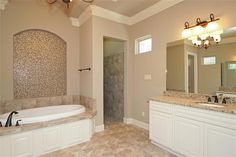 1334 Autumnwood Magnolia, TX 77354: Photo Lots of counter space with his and hers  separate vanities. Doorless walk-in shower that you must see to appreciate the size!