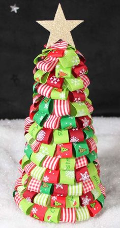 a tree using ribbon pinned to a polystyrene cone.from Samantha Muse's Cone Tree page.tons of awesome pins! Cone Christmas Trees, Ribbon On Christmas Tree, Christmas Tree Crafts, Xmas Tree, All Things Christmas, Christmas Time, Christmas Decorations, Christmas Ornaments, Cone Trees