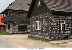 The painted wooden houses in the Village of Cicmany in Slovakia. Wooden Houses, Cottages, Gardens, Cabin, Homes, Architecture, House Styles, Places, Painting