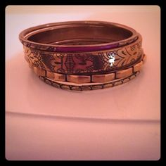 Free people bangles set of 4 free people bangles, relatively new, gold with a few colored bangles and detailing Free People Jewelry Bracelets