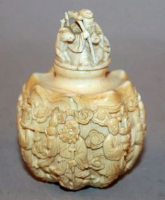 A FINE QUALITY 19TH CENTURY CHINESE IVORY SNUFF BOTTLE & STOPPER, the sides of the fluted bulbous body finely carved in detailed relief with the Eight Taoist Immortals standing amidst cloud scrolls, the stopper carved with Shou Lao holding a peach and in the company of a deer, 2.6in high overall.