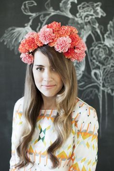 Flower crown, loose waves, brushed curls via She Lets Her Hair Down