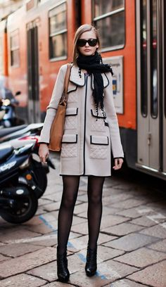 slate coat w/black trim, black tights & shoes + wrapped scarf- très parisienne