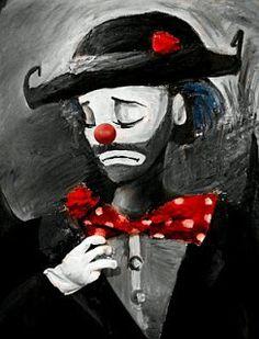 Dibujo de payaso triste con una gran corbata roja.