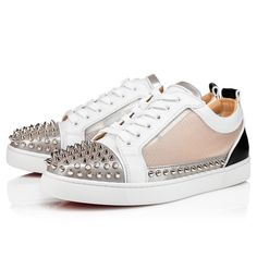 For a demonstration of Maison Christian Louboutin creativity, look no further than the Sosoxy Junior Spikes sneaker that portrays an innovative and daring style. This model is designed using translucent PVC for the quarter. Signature silver spikes are affixed on the front and the sides. It comes with a pair of white socks wearing the signature of Christian Louboutin. Louboutin Online, Red Sole, Online Boutiques, Casual Shoes, Men's Shoes, High Top Sneakers, Christian Louboutin, Socks, Pairs