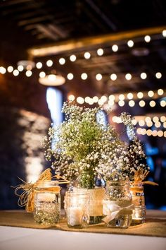 Baby's breath flower centerpieces in Mason Jars with candel