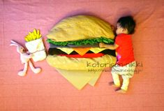 sleeping baby eatting a supersize burger