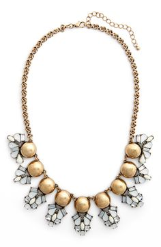 Wearing this pretty statement necklace accented with brassy orbs and bright crystals for a glammed-up boholook.