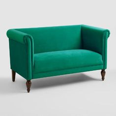Brighten your seating arrangement with our Emerald Marian Loveseat. With rolled shelter arms and sumptuous bright green velvet upholstery, it's a fresh take on a cozy classic.