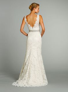 Gorgeous A-line bridal gown, V-neckline front and back, accented with crystal embroidered waist