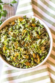 Crispy green rice, made green from lots of finely chopped herbs, currants, and thinly sliced sugar snap peas. Perfect for spring and summer picnics. Recipe on http://thewimpyvegetarian.com blog.