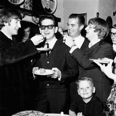 Happy 76th Birthday Roy Orbison!  That's Roy being fed cake by John Lennon & Ringo Starr of The Beatles!