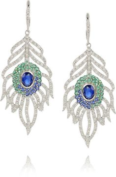 I want these so bad!!! And i can't find them anywhere!!! Kenneth Jay Lane White Silverplated Crystal Peacock Feather Earrings