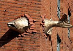 Fish flying through a building - above entrance to South Park Seafood Grill (restaurant) - Portland, Oregon, USA