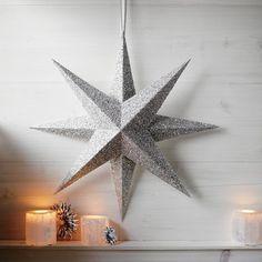 8-zackiger Stern aus silberfarbenem Glitzerpapier